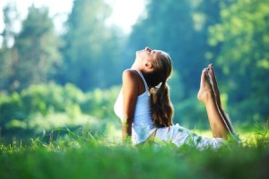 bigstock_yoga_woman_on_green_park_12510542-450x300